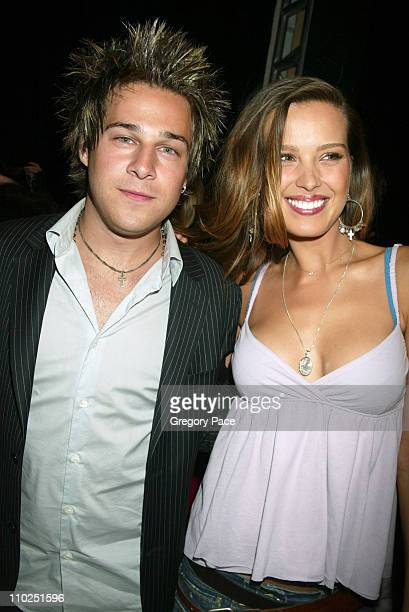 Ryan Cabrera and Petra Nemcova during Olympus Fashion Week Spring 2006 Tommy Hilfiger Front Row and Backstage at Bryant Park in New York City New...