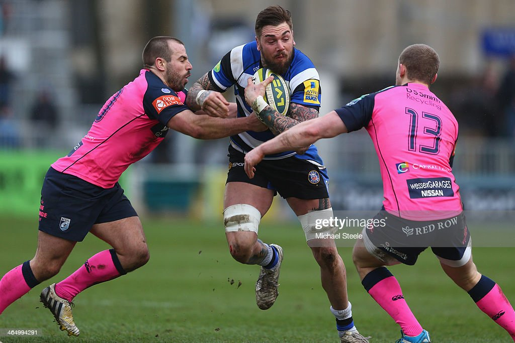 Ryan Caldwell (C) of Bath cuts between Simon Humbersone (L) and Owen Williams (R) of Cardiff Blues during the LV Cup match between Bath and Cardiff Blues at the Recreation Ground on January 25, 2014 in Bath, England.