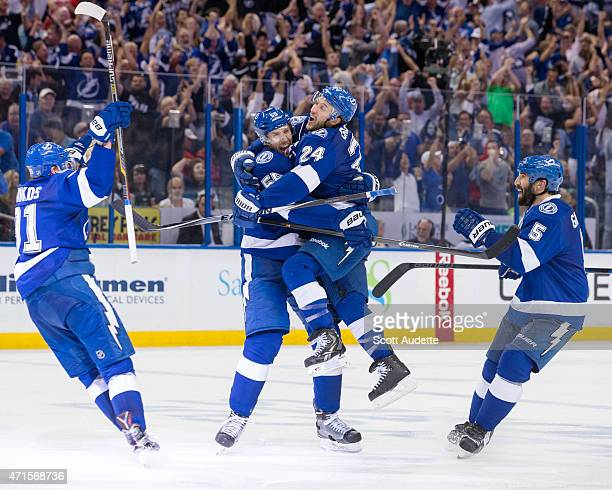 Ryan Callahan jumps into the arms of teammate Braydon Coburn of the Tampa Bay Lightning as they celebrate a goal with teammates Steven Stamkos and...