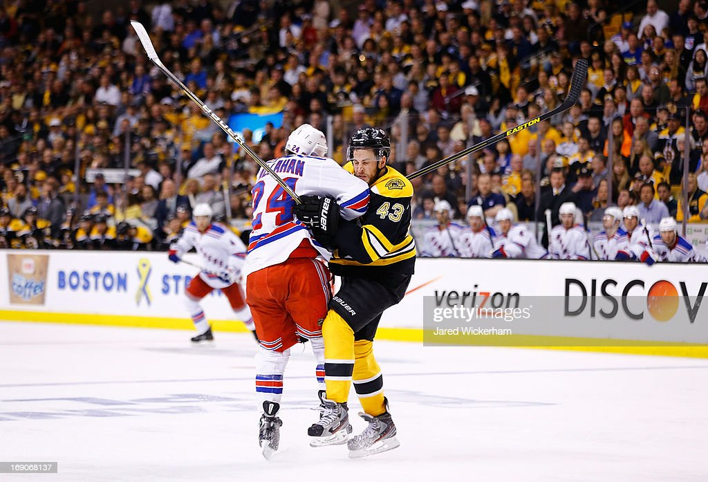 Ryan Callahan #24 of the New York Rangers and Matt Bartkowski #43 of the Boston Bruins collide in the second period in Game Two of the Eastern Conference Semifinals during the 2013 NHL Stanley Cup Playoffs on May 19, 2013 at TD Garden in Boston, Massachusetts.