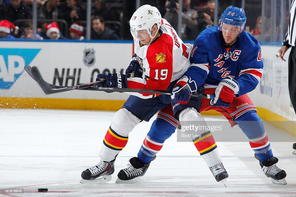 <a gi-track='captionPersonalityLinkClicked' href=/galleries/search?phrase=Ryan+Callahan&family=editorial&specificpeople=809690 ng-click='$event.stopPropagation()'>Ryan Callahan</a> #24 of the New York Rangers and <a gi-track='captionPersonalityLinkClicked' href=/galleries/search?phrase=Scottie+Upshall&family=editorial&specificpeople=209198 ng-click='$event.stopPropagation()'>Scottie Upshall</a> #19 of the Florida Panthers battle for the puck at Madison Square Garden on November 10, 2013 in New York City.