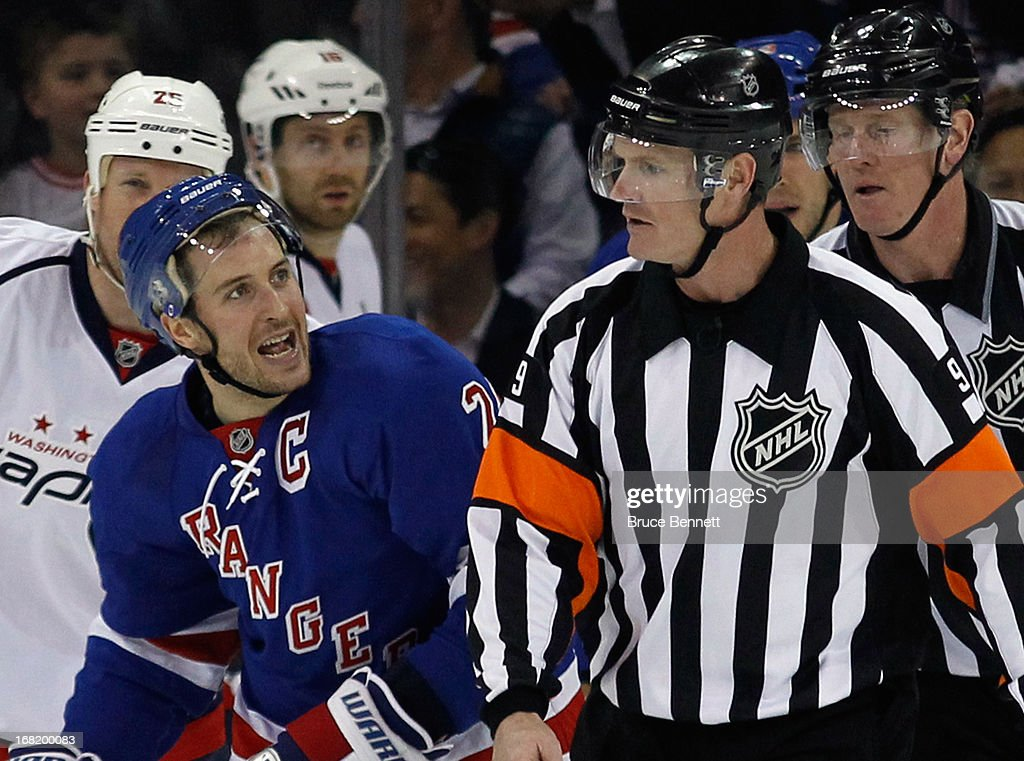 Ryan Callahan #24 of the New York Rangers argues a call with referee Dan O'Rourke #9 during the game against the Washington Capitals in Game Three of the Eastern Conference Quarterfinals during the 2013 NHL Stanley Cup Playoffs at Madison Square Garden on May 6, 2013 in New York City. The Rangers defeated the Capitals 4-3.