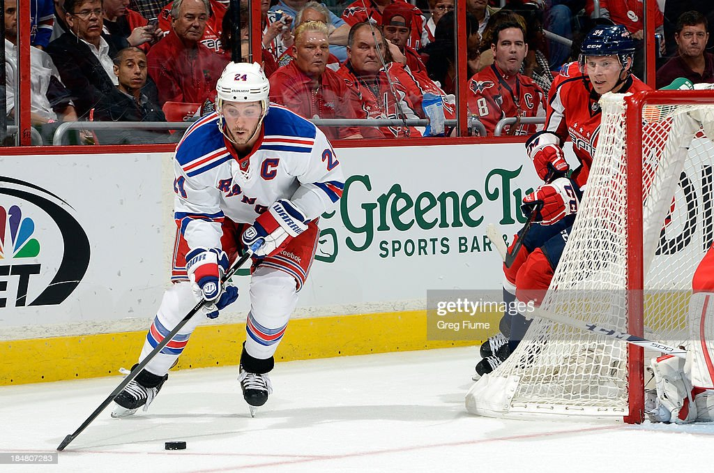 <a gi-track='captionPersonalityLinkClicked' href=/galleries/search?phrase=Ryan+Callahan&family=editorial&specificpeople=809690 ng-click='$event.stopPropagation()'>Ryan Callahan</a> #24 of the New York Rangers brings the puck around the net in the second period against the Washington Capitals at the Verizon Center on October 16, 2013 in Washington, DC.