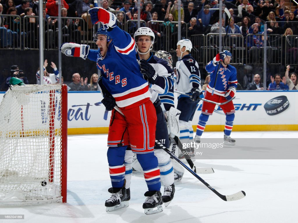<a gi-track='captionPersonalityLinkClicked' href=/galleries/search?phrase=Ryan+Callahan&family=editorial&specificpeople=809690 ng-click='$event.stopPropagation()'>Ryan Callahan</a> #24 of the New York Rangers celebrates a goal against the Winnipeg Jets at Madison Square Garden on April 1, 2013 in New York City. The Rangers defeat the Jets 4-2.