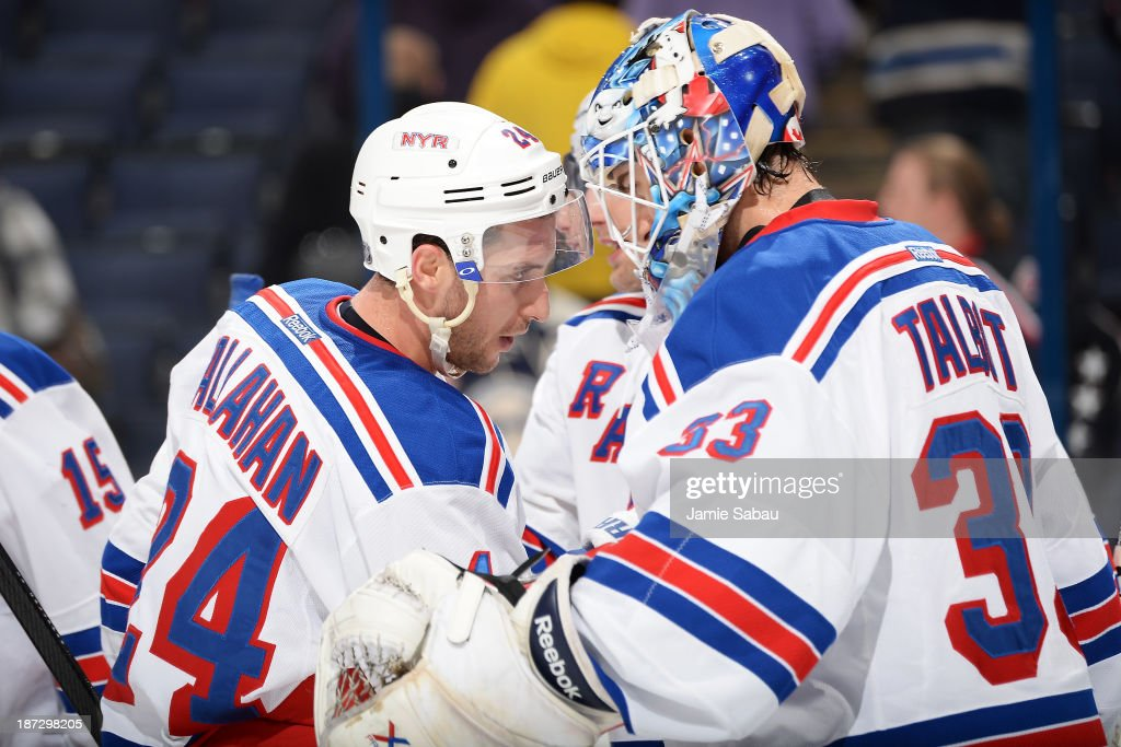 <a gi-track='captionPersonalityLinkClicked' href=/galleries/search?phrase=Ryan+Callahan&family=editorial&specificpeople=809690 ng-click='$event.stopPropagation()'>Ryan Callahan</a> #24 of the New York Rangers celebrates a win against the Columbus Blue Jackets with goaltender <a gi-track='captionPersonalityLinkClicked' href=/galleries/search?phrase=Cam+Talbot&family=editorial&specificpeople=7185126 ng-click='$event.stopPropagation()'>Cam Talbot</a> #33 of the New York Rangers on November 7, 2013 at Nationwide Arena in Columbus, Ohio. New York defeated Columbus 4-2.