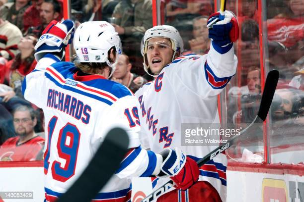 Ryan Callahan of the New York Rangers celebrates his first period goal with teammate Brad Richards in Game Four of the Eastern Conference...