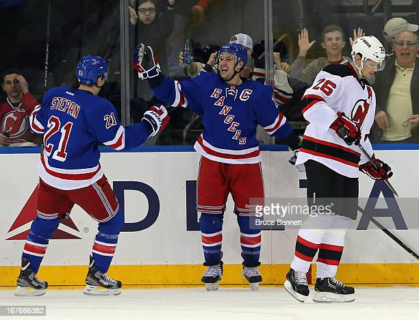 Ryan Callahan of the New York Rangers celebrates his shorthanded goal at 1901 of the first period against the New Jersey Devils along with Derek...