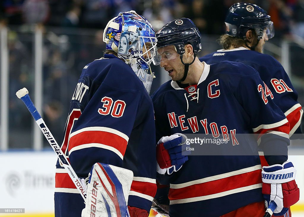 <a gi-track='captionPersonalityLinkClicked' href=/galleries/search?phrase=Ryan+Callahan&family=editorial&specificpeople=809690 ng-click='$event.stopPropagation()'>Ryan Callahan</a> #24 of the New York Rangers celebrates the win with <a gi-track='captionPersonalityLinkClicked' href=/galleries/search?phrase=Henrik+Lundqvist&family=editorial&specificpeople=217958 ng-click='$event.stopPropagation()'>Henrik Lundqvist</a> #30 on February 10, 2013 at Madison Square Garden in New York City.The New York Rangers defeated the Tampa Bay Lightning 5-1.