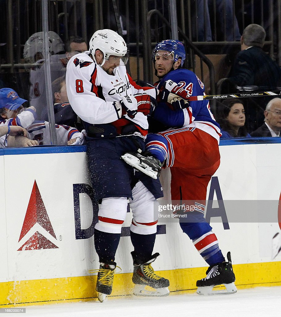 <a gi-track='captionPersonalityLinkClicked' href=/galleries/search?phrase=Ryan+Callahan&family=editorial&specificpeople=809690 ng-click='$event.stopPropagation()'>Ryan Callahan</a> #24 of the New York Rangers checks Alex Ovechkin #8 of the Washington Capitals in Game Three of the Eastern Conference Quarterfinals during the 2013 NHL Stanley Cup Playoffs at Madison Square Garden on May 6, 2013 in New York City. The Rangers defeated the Capitals 4-3.