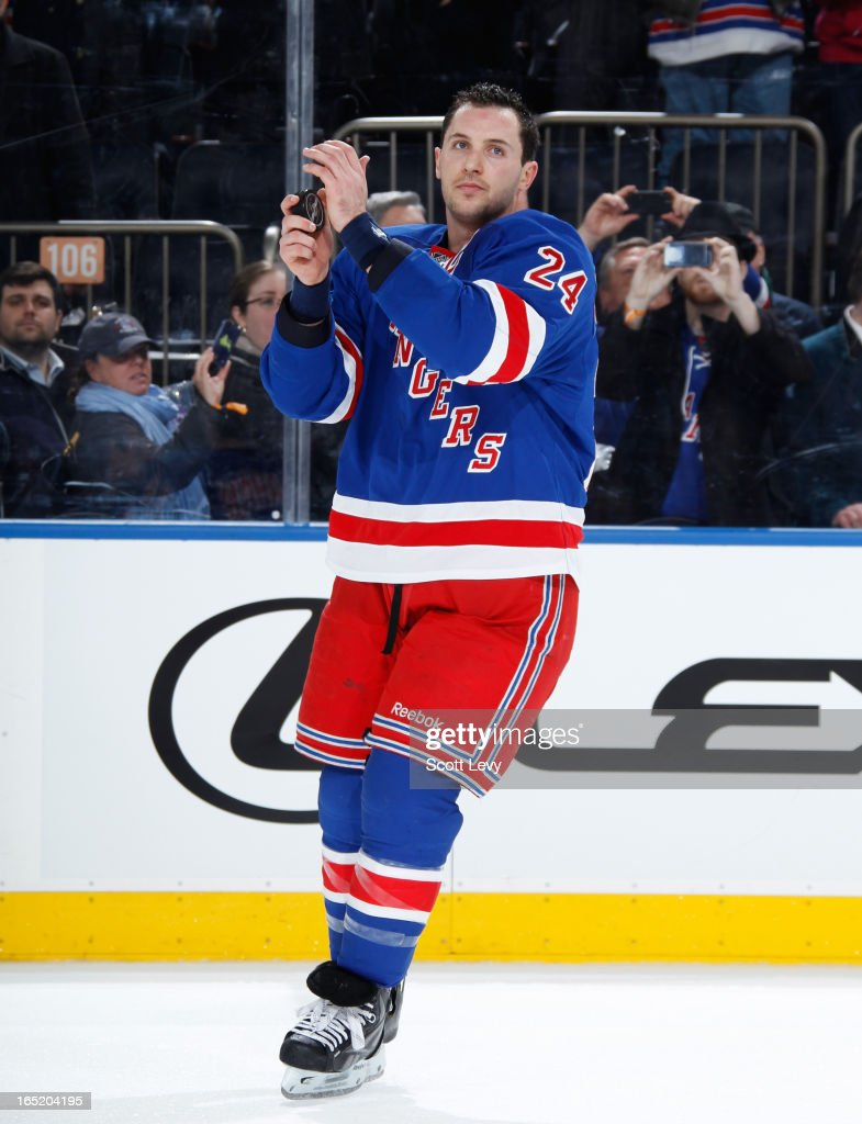 <a gi-track='captionPersonalityLinkClicked' href=/galleries/search?phrase=Ryan+Callahan&family=editorial&specificpeople=809690 ng-click='$event.stopPropagation()'>Ryan Callahan</a> #24 of the New York Rangers cheers with fans as the number one star of the game against the Winnipeg Jets at Madison Square Garden on April 1, 2013 in New York City. The Rangers defeat the Jets 4-2.