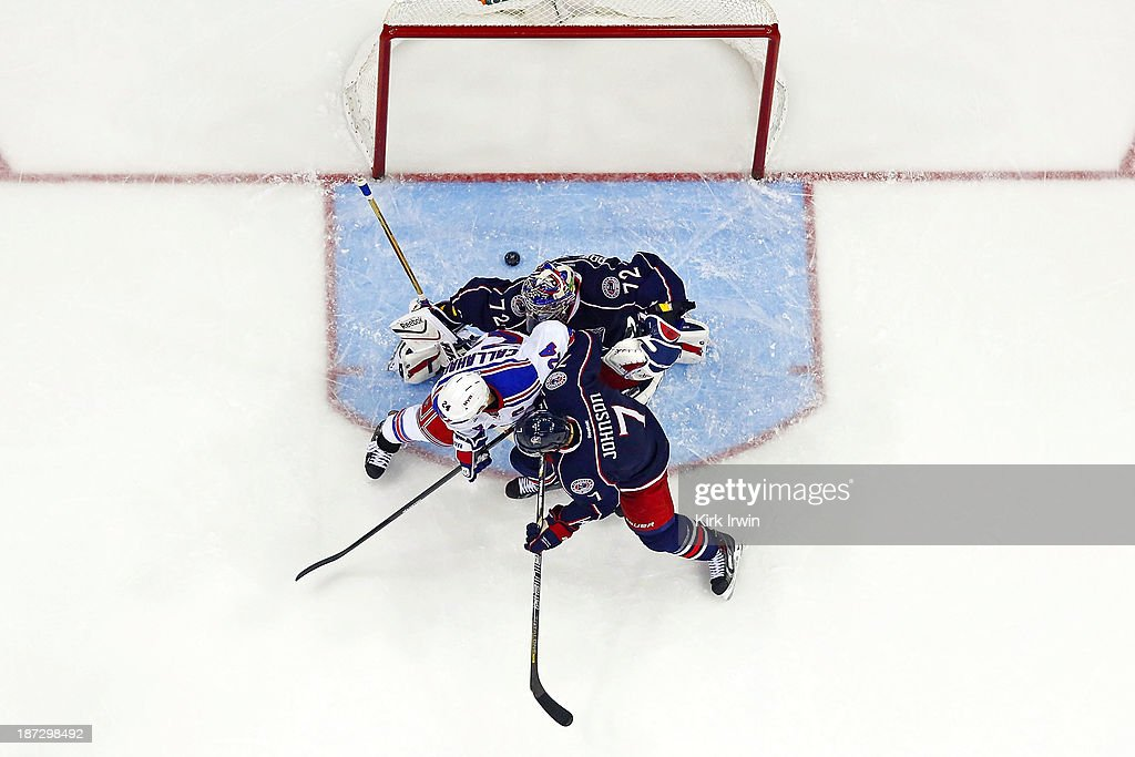 <a gi-track='captionPersonalityLinkClicked' href=/galleries/search?phrase=Ryan+Callahan&family=editorial&specificpeople=809690 ng-click='$event.stopPropagation()'>Ryan Callahan</a> #24 of the New York Rangers deflects the puck past <a gi-track='captionPersonalityLinkClicked' href=/galleries/search?phrase=Sergei+Bobrovsky&family=editorial&specificpeople=4488556 ng-click='$event.stopPropagation()'>Sergei Bobrovsky</a> #72 of the Columbus Blue Jackets during the second period on November 7, 2013 at Nationwide Arena in Columbus, Ohio. New York defeated Columbus 4-2.