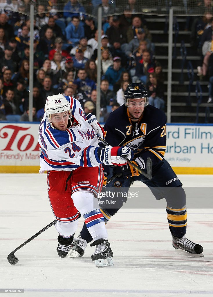 Ryan Callahan #24 of the New York Rangers fires a shot in front of Drew Stafford #21 of the Buffalo Sabres at First Niagara Center on April 19, 2013 in Buffalo, New York.