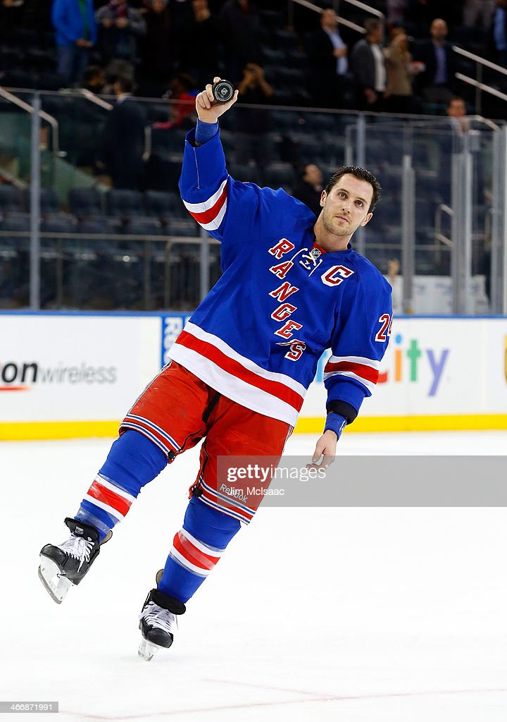 <a gi-track='captionPersonalityLinkClicked' href=/galleries/search?phrase=Ryan+Callahan&family=editorial&specificpeople=809690 ng-click='$event.stopPropagation()'>Ryan Callahan</a> #24 of the New York Rangers salutes the crowd after he was named star of the game against the Colorado Avalanche at Madison Square Garden on February 4, 2014 in New York City.