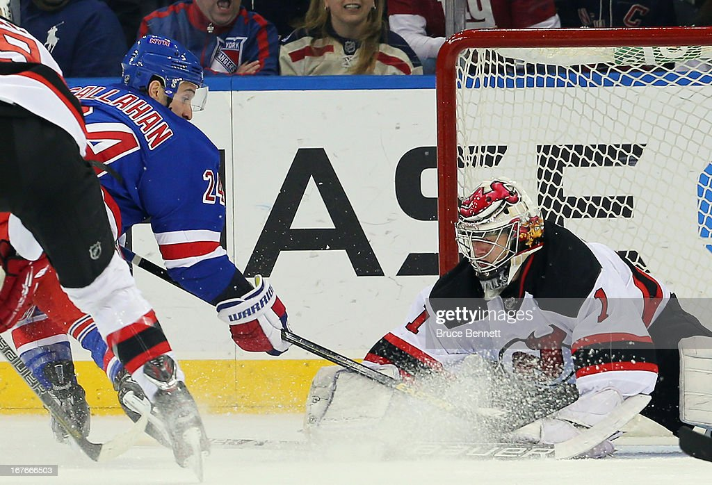 Ryan Callahan of the New York Rangers scores a shorthanded goal at 1901 of the first period against Johan Hedberg of the New Jersey Devils at Madison...