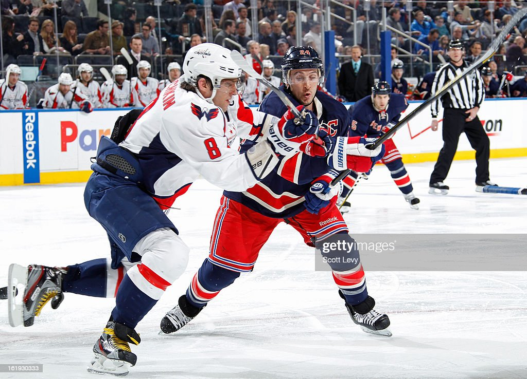 <a gi-track='captionPersonalityLinkClicked' href=/galleries/search?phrase=Ryan+Callahan&family=editorial&specificpeople=809690 ng-click='$event.stopPropagation()'>Ryan Callahan</a> #24 of the New York Rangers skates against <a gi-track='captionPersonalityLinkClicked' href=/galleries/search?phrase=Alexander+Ovechkin&family=editorial&specificpeople=184488 ng-click='$event.stopPropagation()'>Alexander Ovechkin</a> #8 of the Washington Capitals at Madison Square Garden on February 17, 2013 in New York City. The Rangers defeat the Capitals 2-1.