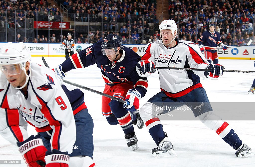 <a gi-track='captionPersonalityLinkClicked' href=/galleries/search?phrase=Ryan+Callahan&family=editorial&specificpeople=809690 ng-click='$event.stopPropagation()'>Ryan Callahan</a> #24 of the New York Rangers skates against <a gi-track='captionPersonalityLinkClicked' href=/galleries/search?phrase=Jason+Chimera&family=editorial&specificpeople=211264 ng-click='$event.stopPropagation()'>Jason Chimera</a> #25 of the Washington Capitals at Madison Square Garden on February 17, 2013 in New York City. The Rangers defeat the Capitals 2-1.