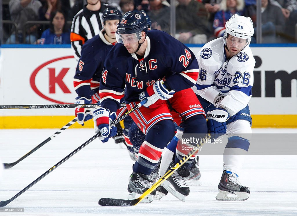 <a gi-track='captionPersonalityLinkClicked' href=/galleries/search?phrase=Ryan+Callahan&family=editorial&specificpeople=809690 ng-click='$event.stopPropagation()'>Ryan Callahan</a> #24 of the New York Rangers skates against <a gi-track='captionPersonalityLinkClicked' href=/galleries/search?phrase=Martin+St.+Louis&family=editorial&specificpeople=202067 ng-click='$event.stopPropagation()'>Martin St. Louis</a> #26 of the Tampa Bay Lightning at Madison Square Garden on February 10, 2013 in New York City. The Rangers defeat the Lightning 5-1.