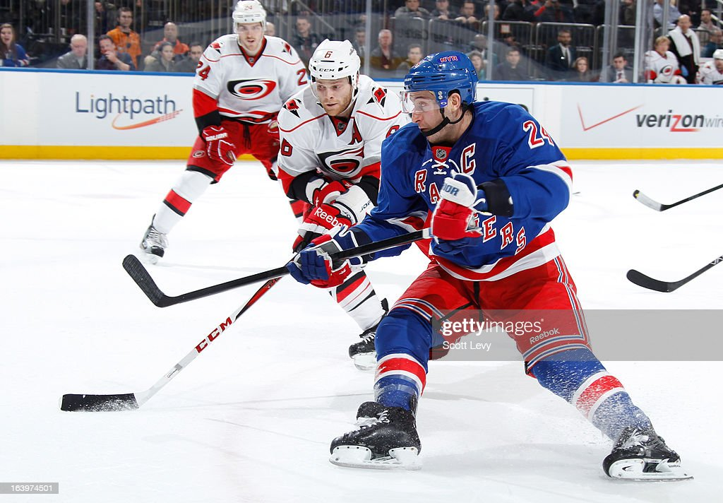 <a gi-track='captionPersonalityLinkClicked' href=/galleries/search?phrase=Ryan+Callahan&family=editorial&specificpeople=809690 ng-click='$event.stopPropagation()'>Ryan Callahan</a> #24 of the New York Rangers skates past <a gi-track='captionPersonalityLinkClicked' href=/galleries/search?phrase=Tim+Gleason&family=editorial&specificpeople=211575 ng-click='$event.stopPropagation()'>Tim Gleason</a> #6 of the Carolina Hurricanes at Madison Square Garden on March 18, 2013 in New York City.