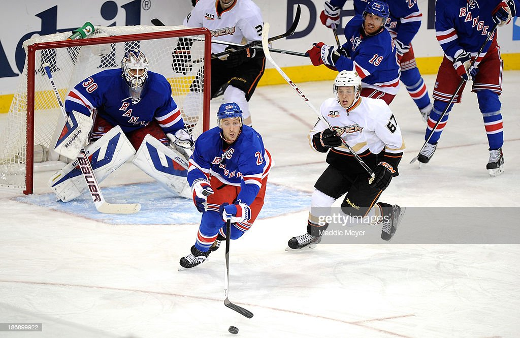<a gi-track='captionPersonalityLinkClicked' href=/galleries/search?phrase=Ryan+Callahan&family=editorial&specificpeople=809690 ng-click='$event.stopPropagation()'>Ryan Callahan</a> #24 of the New York Rangers strains for the puck during the third period against the Anaheim Ducks at Madison Square Garden on November 4, 2013 in New York City. The Ducks defeat the Rangers 2-1.