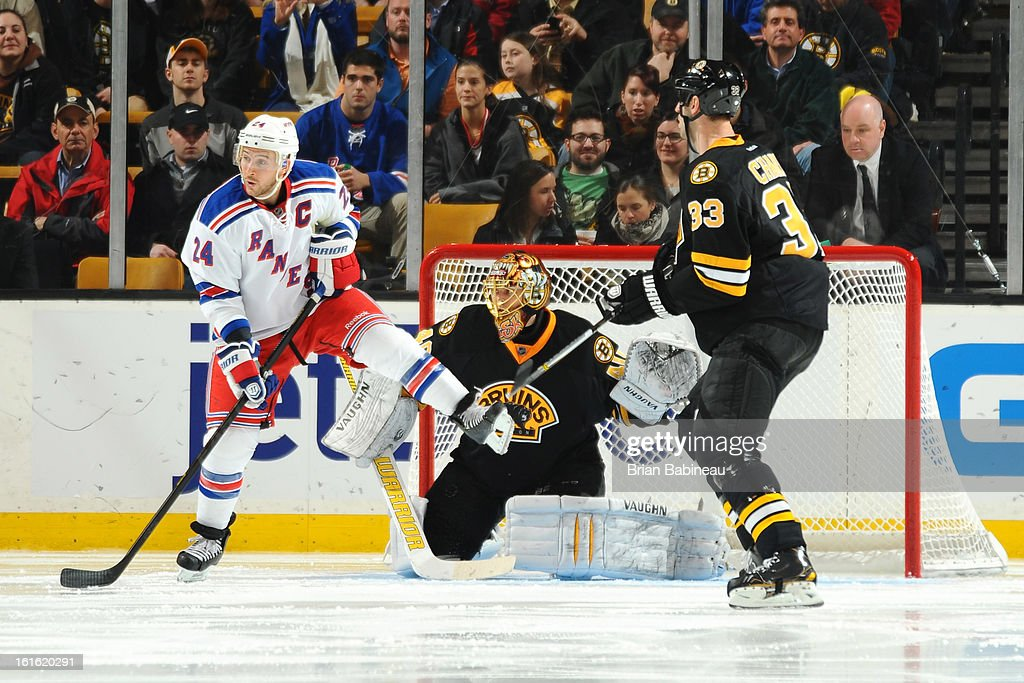 Ryan Callahan #24 of the New York Rangers watches the play against Tuukka Rask #40 and Zdeno Chara #33 of the Boston Bruins at the TD Garden on February 12, 2013 in Boston, Massachusetts.