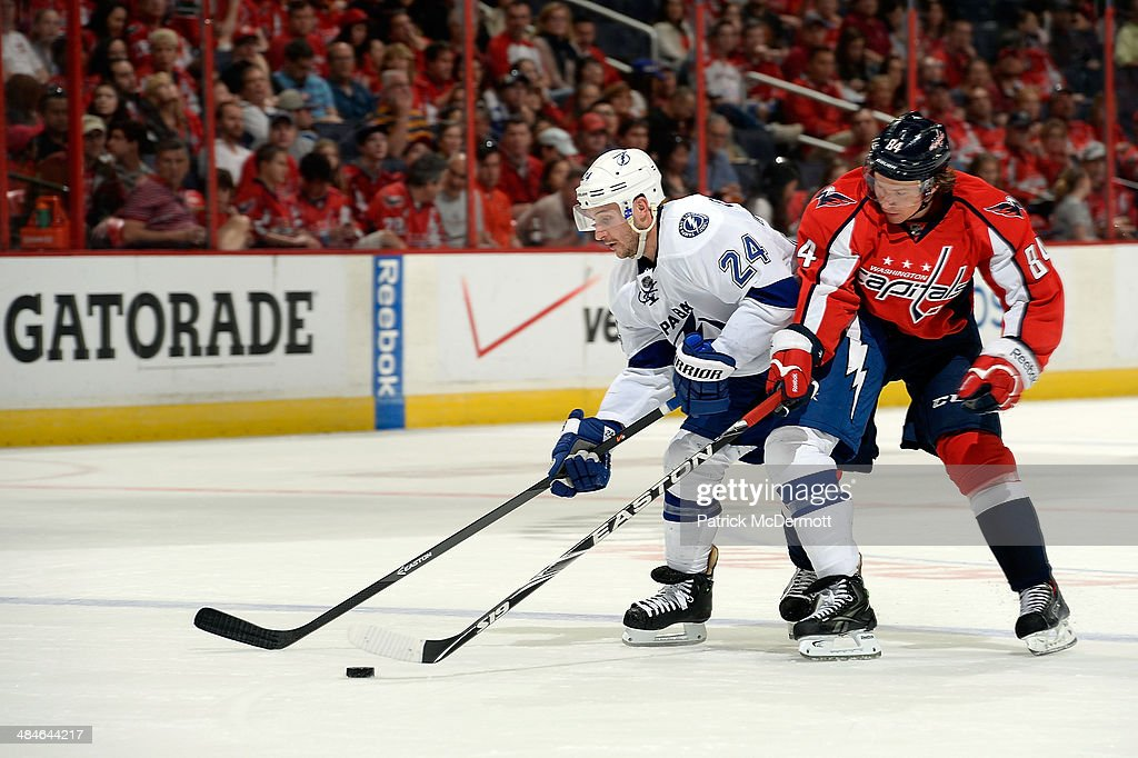 <a gi-track='captionPersonalityLinkClicked' href=/galleries/search?phrase=Ryan+Callahan&family=editorial&specificpeople=809690 ng-click='$event.stopPropagation()'>Ryan Callahan</a> #24 of the Tampa Bay Lightning and <a gi-track='captionPersonalityLinkClicked' href=/galleries/search?phrase=Mikhail+Grabovski&family=editorial&specificpeople=2560547 ng-click='$event.stopPropagation()'>Mikhail Grabovski</a> #84 of the Washington Capitals battle for the puck during the second period of an NHL game at Verizon Center on April 13, 2014 in Washington, DC.