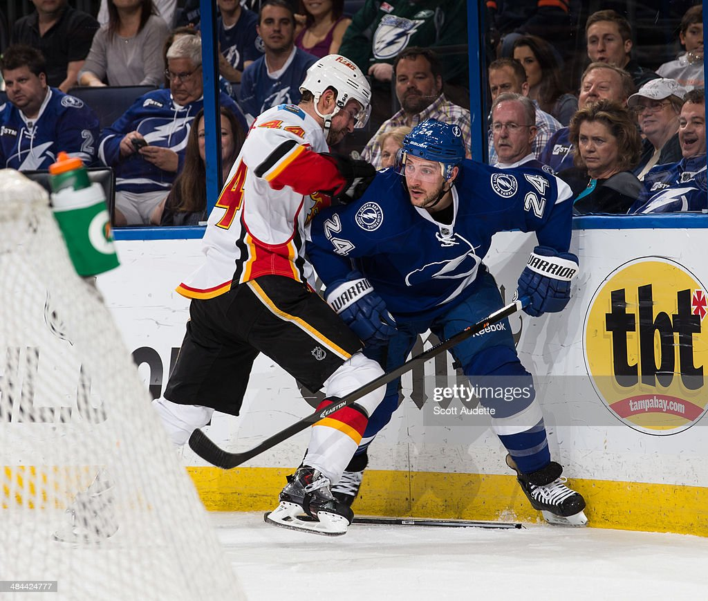 Ryan Callahan #24 of the Tampa Bay Lightning battles against Chris Butler #44 of the Calgary Flames during the first period at the Tampa Bay Times Forum on April 3, 2014 in Tampa, Florida.