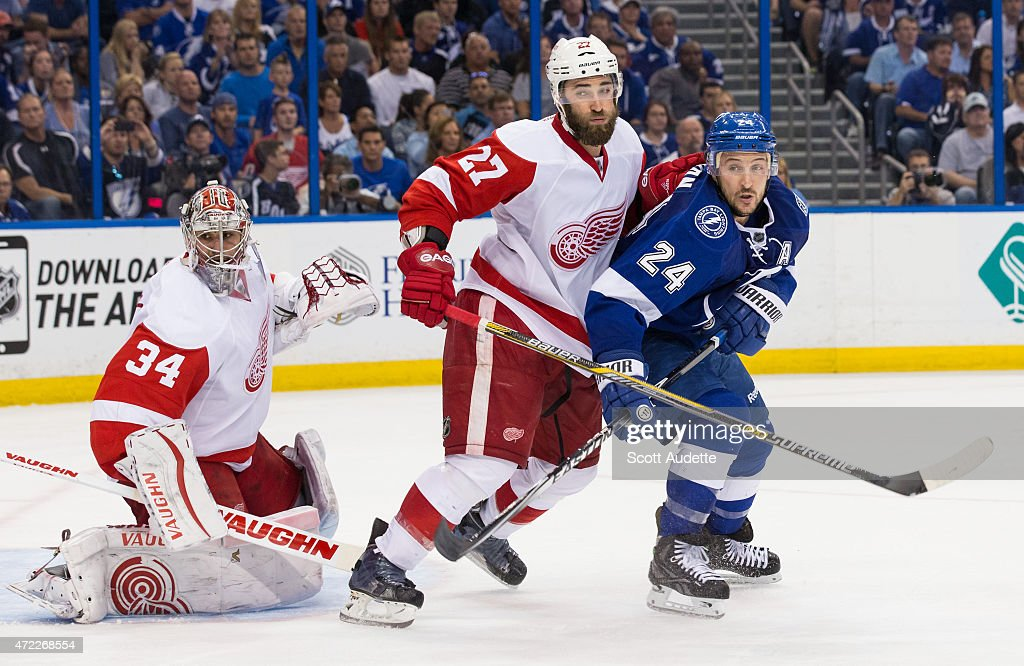 Ryan Callahan of the Tampa Bay Lightning battles against Kyle Quincey of the Detroit Red Wings in front of goalie Petr Mrazek during the third period...