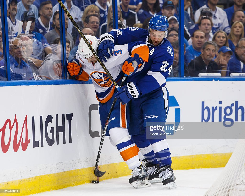 <a gi-track='captionPersonalityLinkClicked' href=/galleries/search?phrase=Ryan+Callahan&family=editorial&specificpeople=809690 ng-click='$event.stopPropagation()'>Ryan Callahan</a> #24 of the Tampa Bay Lightning battles against <a gi-track='captionPersonalityLinkClicked' href=/galleries/search?phrase=Travis+Hamonic&family=editorial&specificpeople=4605791 ng-click='$event.stopPropagation()'>Travis Hamonic</a> #3 of the New York Islanders during the first period of Game Two of the Eastern Conference Second Round in the 2016 NHL Stanley Cup Playoffs at the Amalie Arena on April 30, 2016 in Tampa, Florida.