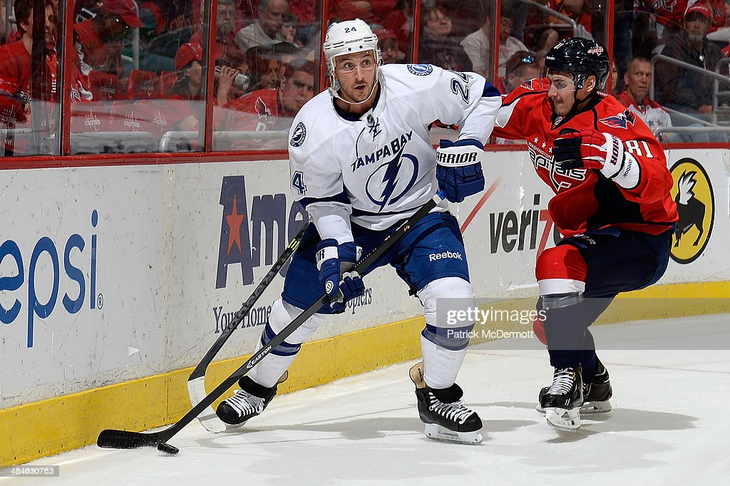 Ryan Callahan #24 of the Tampa Bay Lightning battles for the puck against Dmitry Orlov #81 of the Washington Capitals in the first period during an NHL game at Verizon Center on April 13, 2014 in Washington, DC.