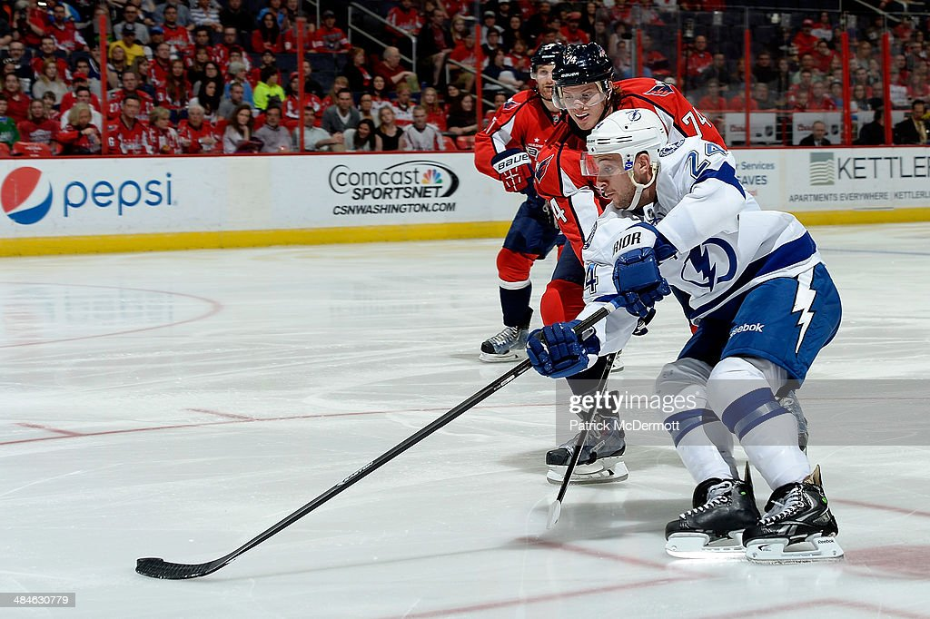 <a gi-track='captionPersonalityLinkClicked' href=/galleries/search?phrase=Ryan+Callahan&family=editorial&specificpeople=809690 ng-click='$event.stopPropagation()'>Ryan Callahan</a> #24 of the Tampa Bay Lightning battles for the puck against John Carlson #74 of the Washington Capitals in the first period during an NHL game at Verizon Center on April 13, 2014 in Washington, DC.