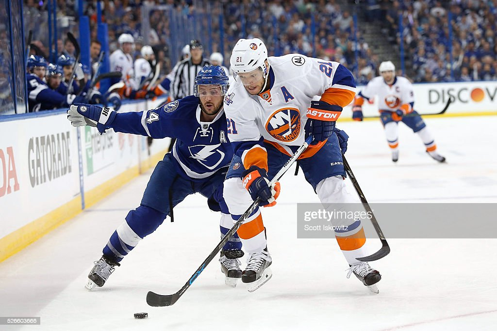 Ryan Callahan of the Tampa Bay Lightning battles for the puck against Kyle Okposo of the New York Islanders during the first period in Game Two of...