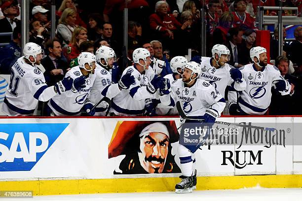 Ryan Callahan of the Tampa Bay Lightning celebrates a first period goal with teammates against the Chicago Blackhawks during Game Three of the 2015...