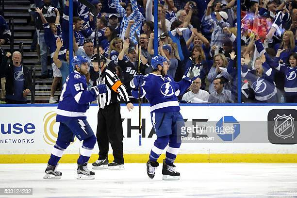 Ryan Callahan of the Tampa Bay Lightning celebrates after scoring a goal against Matt Murray of the Pittsburgh Penguins during the first period in...