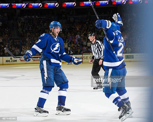 Ryan Callahan of the Tampa Bay Lightning celebrates his game winning goal with teammate Victor Hedman against the Florida Panthers during the third...