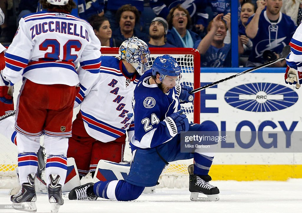 <a gi-track='captionPersonalityLinkClicked' href=/galleries/search?phrase=Ryan+Callahan&family=editorial&specificpeople=809690 ng-click='$event.stopPropagation()'>Ryan Callahan</a> #24 of the Tampa Bay Lightning celebrates his goal in front of <a gi-track='captionPersonalityLinkClicked' href=/galleries/search?phrase=Henrik+Lundqvist&family=editorial&specificpeople=217958 ng-click='$event.stopPropagation()'>Henrik Lundqvist</a> #30 of the New York Rangers at the Amalie Arena on November 26, 2014 in Tampa, Florida.