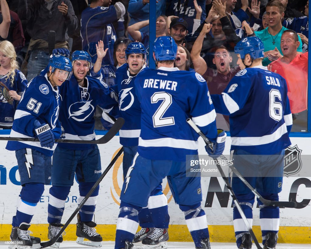 Ryan Callahan of the Tampa Bay Lightning celebrates his second goal of the game with Valtteri Filppula Alex Killorn and teammates during the third...
