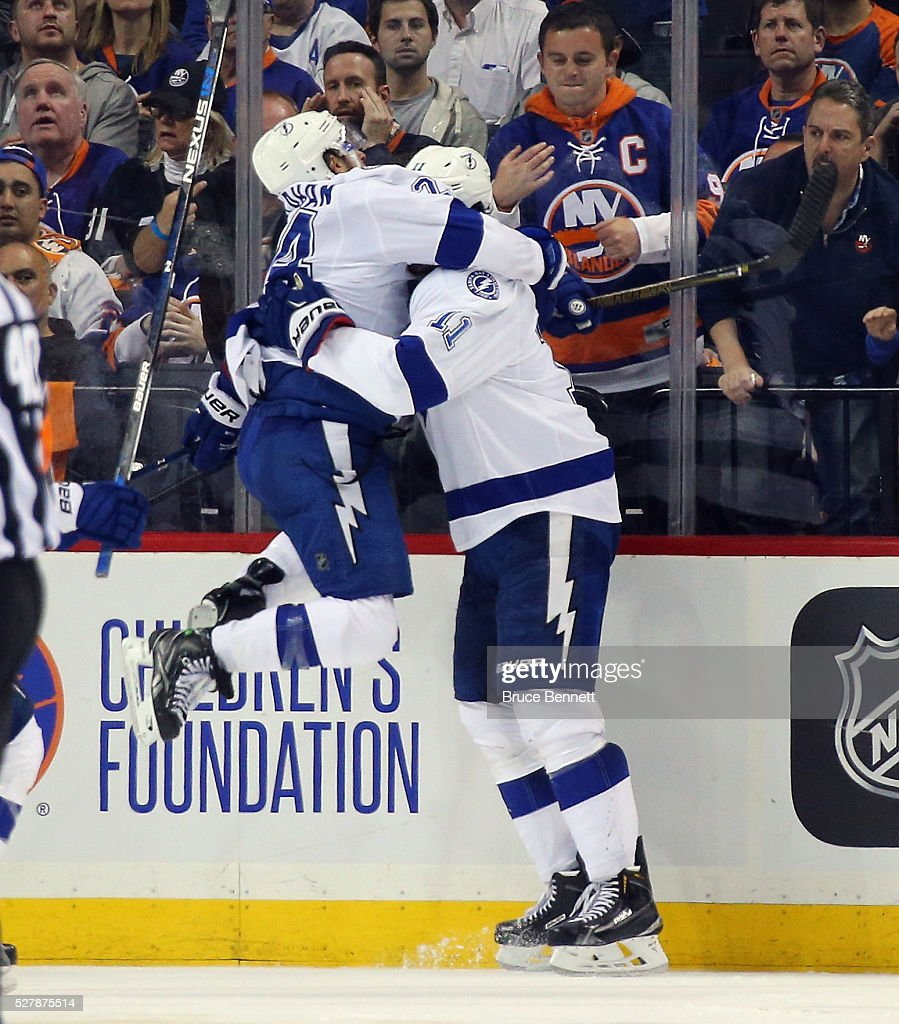 <a gi-track='captionPersonalityLinkClicked' href=/galleries/search?phrase=Ryan+Callahan&family=editorial&specificpeople=809690 ng-click='$event.stopPropagation()'>Ryan Callahan</a> #24 of the Tampa Bay Lightning celebrates the game winning goal by <a gi-track='captionPersonalityLinkClicked' href=/galleries/search?phrase=Brian+Boyle+-+Ice+Hockey+Player&family=editorial&specificpeople=8986264 ng-click='$event.stopPropagation()'>Brian Boyle</a> #11 (r) at 2:48 of the first overtime against the New York Islanders in Game Three of the Eastern Conference Second Round during the 2016 NHL Stanley Cup Playoffs at the Barclays Center on May 03, 2016 in the Brooklyn borough of New York City. The Lightning defeated the Islanders 5-4 in overtime.