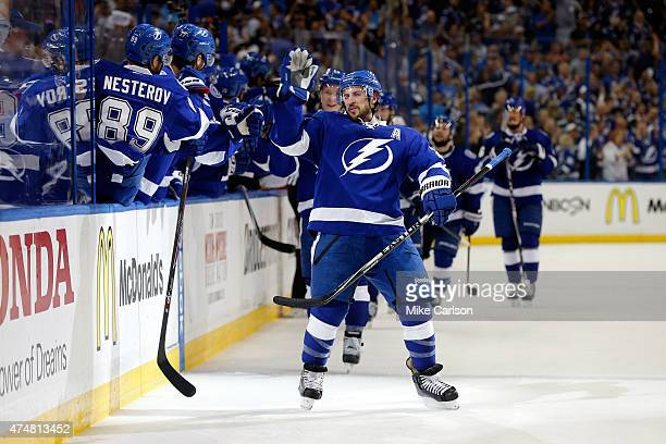 Ryan Callahan of the Tampa Bay Lightning celebrates with his teammates after scoring a goal against Henrik Lundqvist of the New York Rangers during...