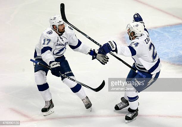 Ryan Callahan of the Tampa Bay Lightning celebrates with teammate Alex Killorn after scoring a goal on Corey Crawford of the Chicago Blackhawks in...