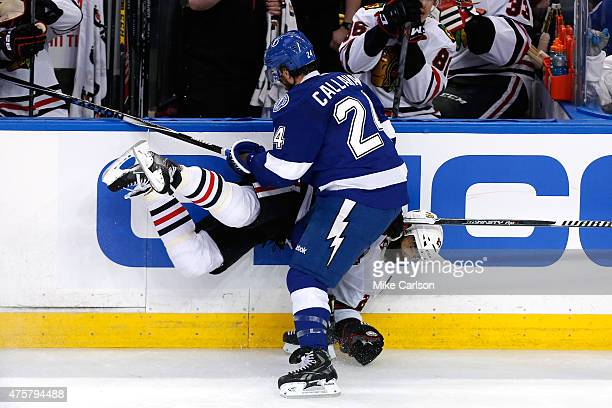 Ryan Callahan of the Tampa Bay Lightning checks Johnny Oduya of the Chicago Blackhawks in the second period during Game One of the 2015 NHL Stanley...
