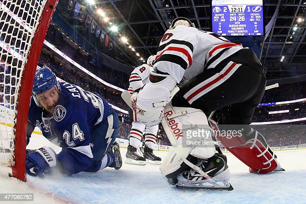 Ryan Callahan of the Tampa Bay Lightning collides with Corey Crawford of the Chicago Blackhawks during the third period in Game Five of the 2015 NHL...