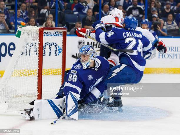 Ryan Callahan of the Tampa Bay Lightning collides with goalie Andrei Vasilevskiy with Brett Connolly of the Washington Capitals during the second...