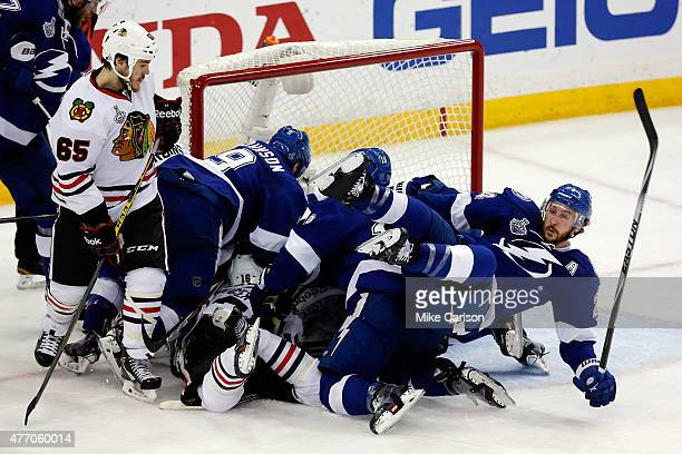 Ryan Callahan of the Tampa Bay Lightning gets knocked to the ice during a pile up in front of the net in the third period against the Chicago...