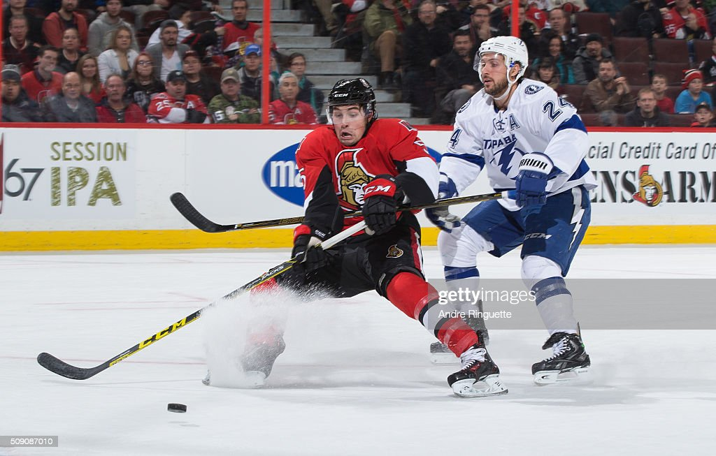 <a gi-track='captionPersonalityLinkClicked' href=/galleries/search?phrase=Ryan+Callahan&family=editorial&specificpeople=809690 ng-click='$event.stopPropagation()'>Ryan Callahan</a> #24 of the Tampa Bay Lightning hooks <a gi-track='captionPersonalityLinkClicked' href=/galleries/search?phrase=Cody+Ceci&family=editorial&specificpeople=7324783 ng-click='$event.stopPropagation()'>Cody Ceci</a> #5 of the Ottawa Senators off a scoring chance, resulting in a penalty during first period action at Canadian Tire Centre on February 8, 2016 in Ottawa, Ontario, Canada.