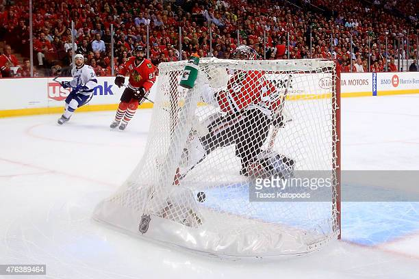 Ryan Callahan of the Tampa Bay Lightning scores a goal on Corey Crawford of the Chicago Blackhawks in the first period during Game Three of the 2015...