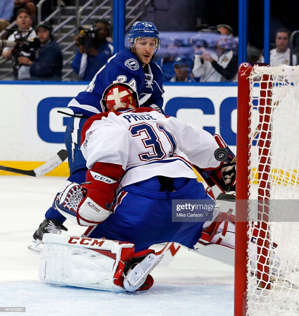 <a gi-track='captionPersonalityLinkClicked' href=/galleries/search?phrase=Ryan+Callahan&family=editorial&specificpeople=809690 ng-click='$event.stopPropagation()'>Ryan Callahan</a> #24 of the Tampa Bay Lightning scores past <a gi-track='captionPersonalityLinkClicked' href=/galleries/search?phrase=Carey+Price&family=editorial&specificpeople=2222083 ng-click='$event.stopPropagation()'>Carey Price</a> #31 of the Montreal Canadiens at the Tampa Bay Times Forum on April 1, 2014 in Tampa, Florida.
