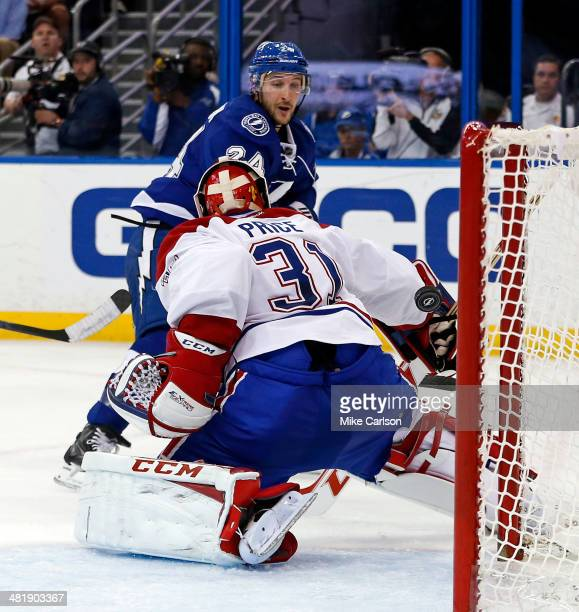 Ryan Callahan of the Tampa Bay Lightning scores past Carey Price of the Montreal Canadiens at the Tampa Bay Times Forum on April 1 2014 in Tampa...