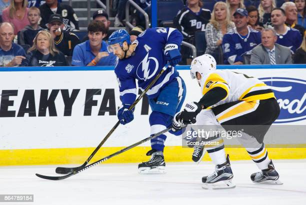 Ryan Callahan of the Tampa Bay Lightning shoots against Brian Dumoulin of the Pittsburgh Penguins during the first period at Amalie Arena on October...