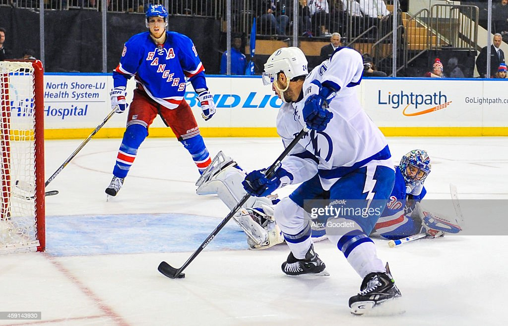 <a gi-track='captionPersonalityLinkClicked' href=/galleries/search?phrase=Ryan+Callahan&family=editorial&specificpeople=809690 ng-click='$event.stopPropagation()'>Ryan Callahan</a> #24 of the Tampa Bay Lightning skates around <a gi-track='captionPersonalityLinkClicked' href=/galleries/search?phrase=Henrik+Lundqvist&family=editorial&specificpeople=217958 ng-click='$event.stopPropagation()'>Henrik Lundqvist</a> #30 of the New York Rangers before scoring a goal in the third period at Madison Square Garden on November 17, 2014 in New York City.