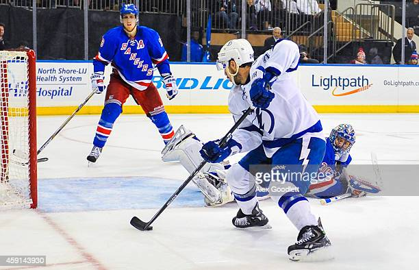 Ryan Callahan of the Tampa Bay Lightning skates around Henrik Lundqvist of the New York Rangers before scoring a goal in the third period at Madison...